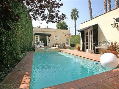 Large heated swimmers pool & fountained spa in private rear yard.