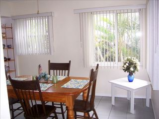Redington Shores cottage photo - Dining area has tropical view and leads to laundry