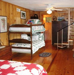 The Downstairs Bedroom with Queen Bed and Twin Bunk Beds