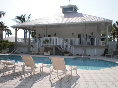 The beautiful newly renovated clubhouse and heated pool at Boca Vista Harbor!