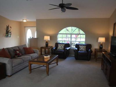 Open, spacious living room and front entrance.
