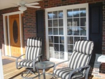 Covered deck seating on lakeside with ceiling fan