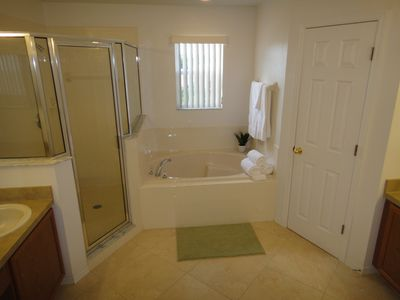 Master bathroom with tile floor extra large shower, and garden tub.