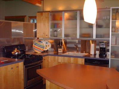 Kitchen is a chef's delight and homage to the 50s, too -- formica countertops!