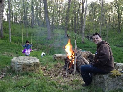 Apple River cabin rental - Enjoying the fire pit and swing on a cool spring day