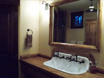 Bunk Room vanity area in bath. Walk in shower, WC, huge custom armoire