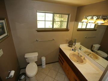 Large bathroom with walk-in shower with body spay and overhead shower