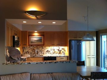Ventura villa rental - Open kitchen/dining/living room with cathedral ceilings, fireplace/hd tv.