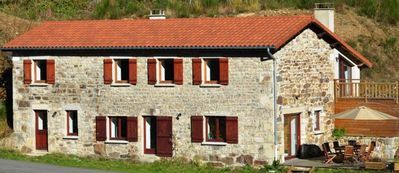 Stone house on the edge of a stream and the forest in the natural park of Pilat