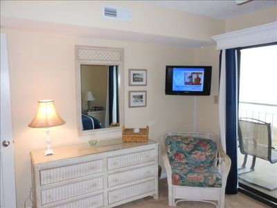 Master Bedroom with Flat Screen TV. Bedroom has Sliding Glass Doors to Balcony.