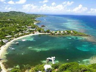 Reef, beach and town show amazing location of Coral Vistas. - Roatan villa vacation rental photo