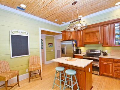 GOURMET KITCHEN WITH THREE OVENS, WINE COOLER & REFRIGERATOR WITH ICE DISPENSER