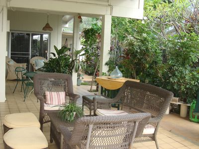 More comfortable seating surrounded with lush tropical gardens.