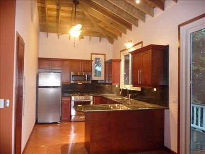 Full modern kitchen with Italian granite counters and a wonderful view