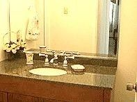 San Juan condo rental - Granite counter in Bathroom sink cabinet