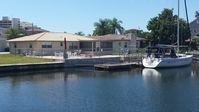 Home on a canal just off the Gulf, pool/w large deck - pets welcome, fenced yard