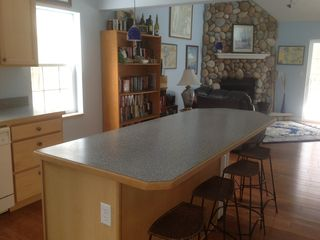 Kitchen with large island leads to the great room