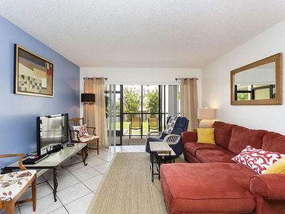 Relax and unwind in our garden view condo - Siesta Dunes Beach 38A is located on the ground floor and is surrounded by beautiful, lush gardens. Our condo has a screened lanai and extended wooded deck.