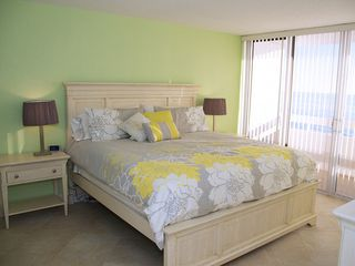 Redington Shores condo photo - King sized sleep number bed and night stands in the master bedroom.