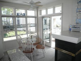 Manistee condo photo - Dinette with dorwall to deck