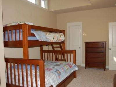 Large vaulted ceilings with queen/ twin bunk beds, desk, large walk in closets