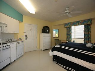 One of the guest bedrooms with a queen size bed and a bonus efficiency kitchen. - Daytona Beach condo vacation rental photo
