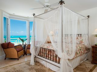 Providenciales - Provo condo photo - Master Bedroom lower level with an ocean view