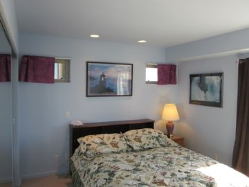 Lower original bedroom painted a relaxing Caribbean blue and new storage bed