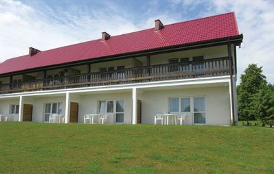 These cozy apartments are situated on a peninsula between the lakes Święcajty and Mam