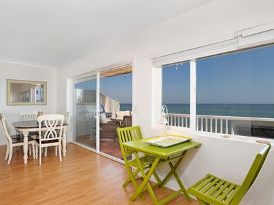 Dining and extra seating area with unobstructed ocean views