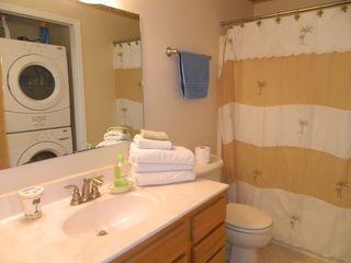 Carolina Beach condo photo - Hall bathroom with a full size washer and dryer.