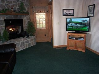 42' flat screen tv in great room - Pigeon Forge cabin vacation rental photo