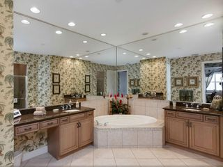 Bonita Springs apartment photo - Master bathroom with over size spa bath and his/hers vanity unit/basins