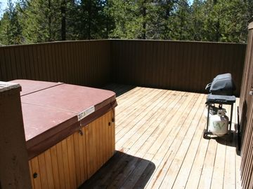 Private back deck with hot tub, patio furniture and BBQ grill