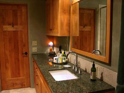 Bathroom. Granite countertops, handmade cabinetry