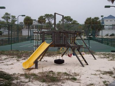 Children's play area and tennis court across from pool!