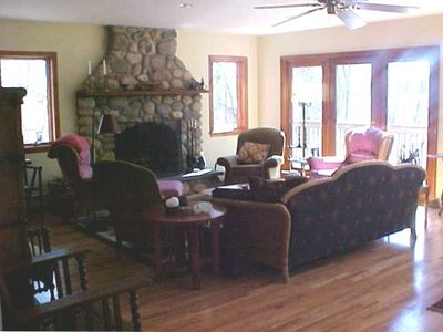 Living room area with field stone fireplace