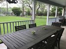 Outdoor patio with dining table and grill