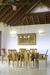Dinning Room with original canvas in background - Cap Estate villa vacation rental photo