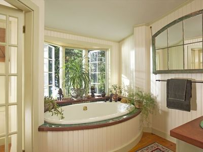 Luxuriate in this master bathroom and jacuzzi overlooking the water!