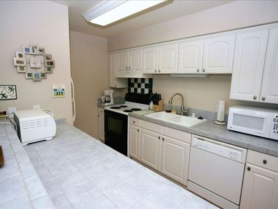 Fully Equipped Kitchen with Oven, Dishwasher, Refrigerator and Microwave