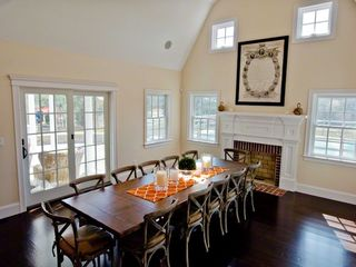 Katama house photo - Dramatic Dining Area Features 2 Story Gambrel Ceiling, Fireplace, Seating For 10 & French Doors To Porch & Pool Area