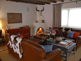 Santa Fe house photo - Main house living room. TV in wall behind doors when needed. iPod dock and Mac