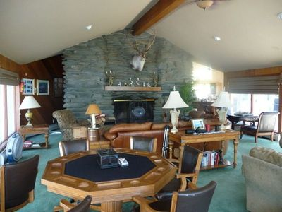 huge family room has a huge fireplace to get a roaring fire, plus mountain views