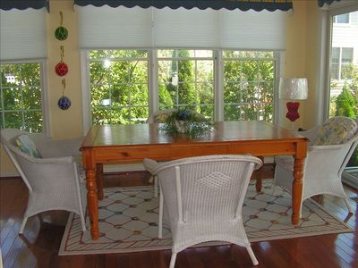 Bethany Beach house rental - View of sunroom with extra seating, entrance to screened porch/garden area