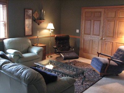 Delightful living room area has a full size sleeper sofa, cable TV & DVD player.