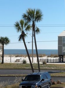 Private deeded beach access with boardwalk just across quiet two lane road.