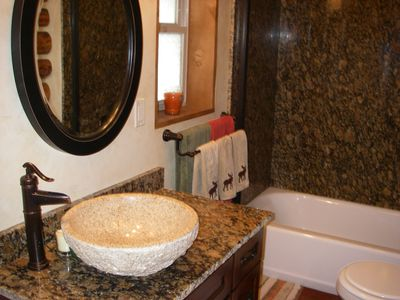 Bathroom. Granite surround in tub/shower. Full size washer and dryer behind door