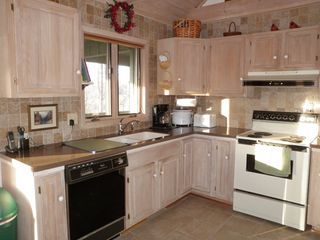 Blowing Rock cottage photo - The view of the kitchen from the dining area. Window faces back porch / yard.