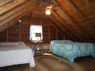 Port Sanilac cottage photo - Upstairs open attack, two double beds and ceiling fan.